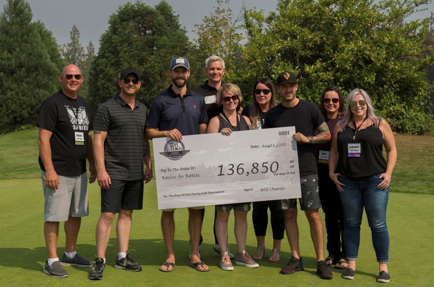 Boys of Fall Charity Golf Tournament - Holding Check of Donation